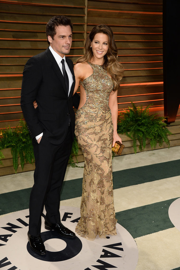 Kate Beckinsale stunned in gold with Len Wiseman.