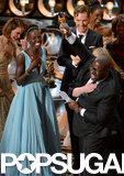 Steve McQueen was beyond excited to win best picture for 12 Years a Slave and his cast, including Lupita Nyong'o and Benedict Cumberbatch, cheered right alongside him.