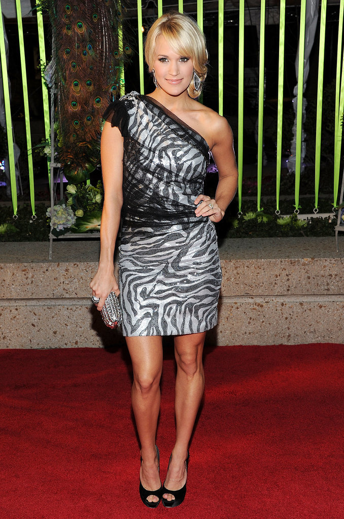 She donned a zebra-print tulle-overlay Roberto de Villacis mini, classic peep-toe pumps, and crystal minaudière for the 2011 Country Music Awards.