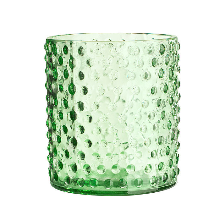 Set an ambiance scattering a few of these green glass votives around your centerpiece — they're only $3!