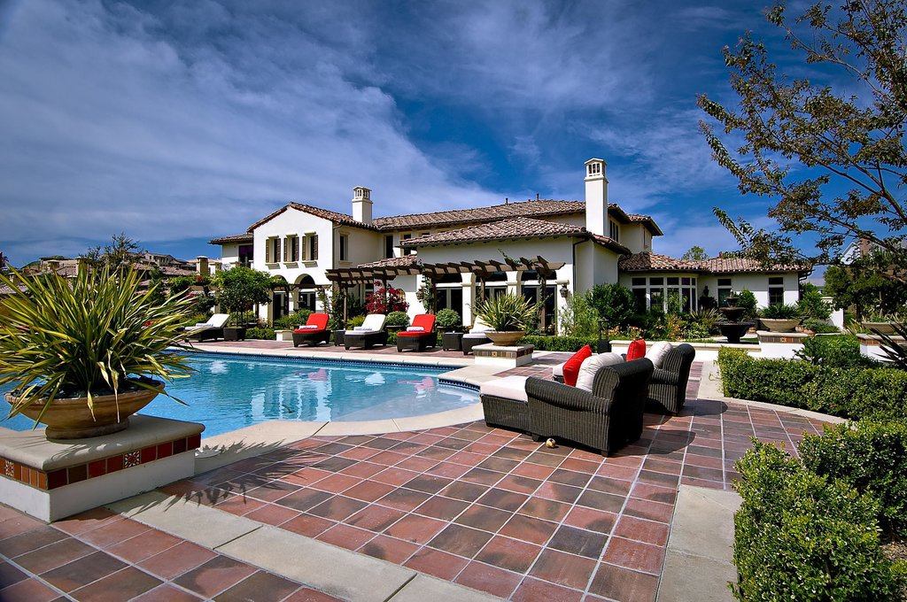 A tiled deck and lounge chairs are a Southern California staple.  Source: Trulia