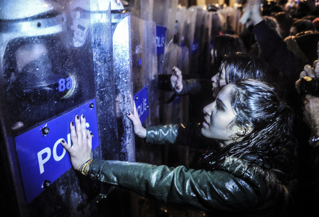 Turkish women went face to face with police officers while marching toward Taksim Square in Istanbul.