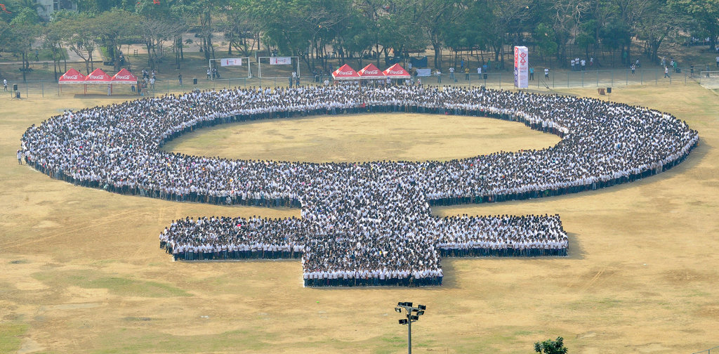 In the Philippines, people gathered to form a human woman symbol.