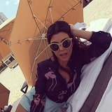 "Kourtney relaxed on the beach on Tuesday. ""MIA...#flamingos #beachlifebaby,"" she wrote in the caption. Source: Instagram user kourtneykardash"