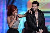 Rihanna and Drake holding hands in Manchester
