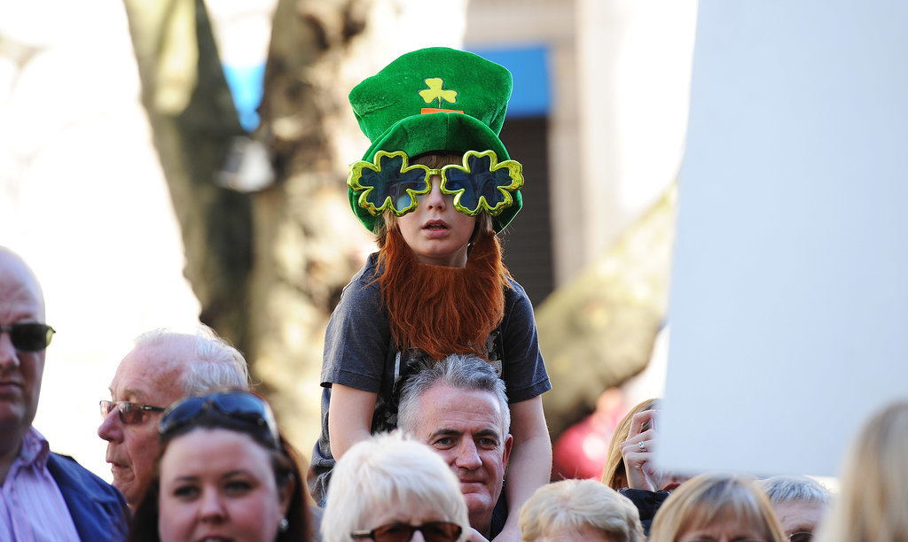 A kid dressed in Irish gear sat on his dad's shoulders during the London parade.