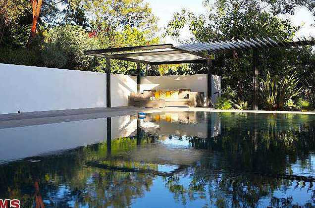 An infinity pool complete with a covered patio is perfect for entertaining.  Source: Redfin
