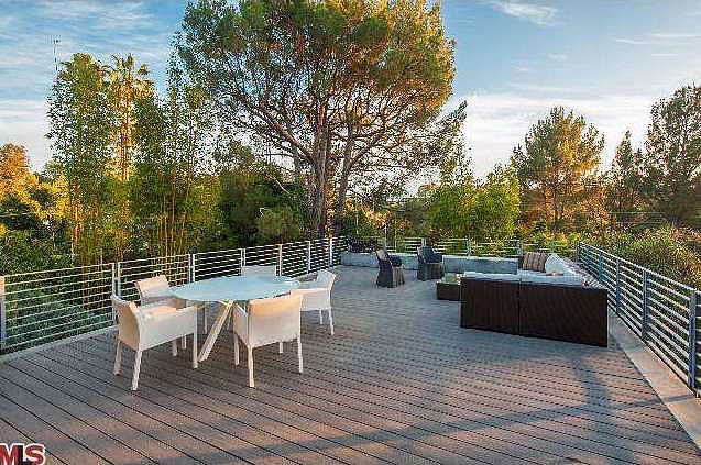 The open deck offers views of the lush Hollywood Hills.  Source: Redfin