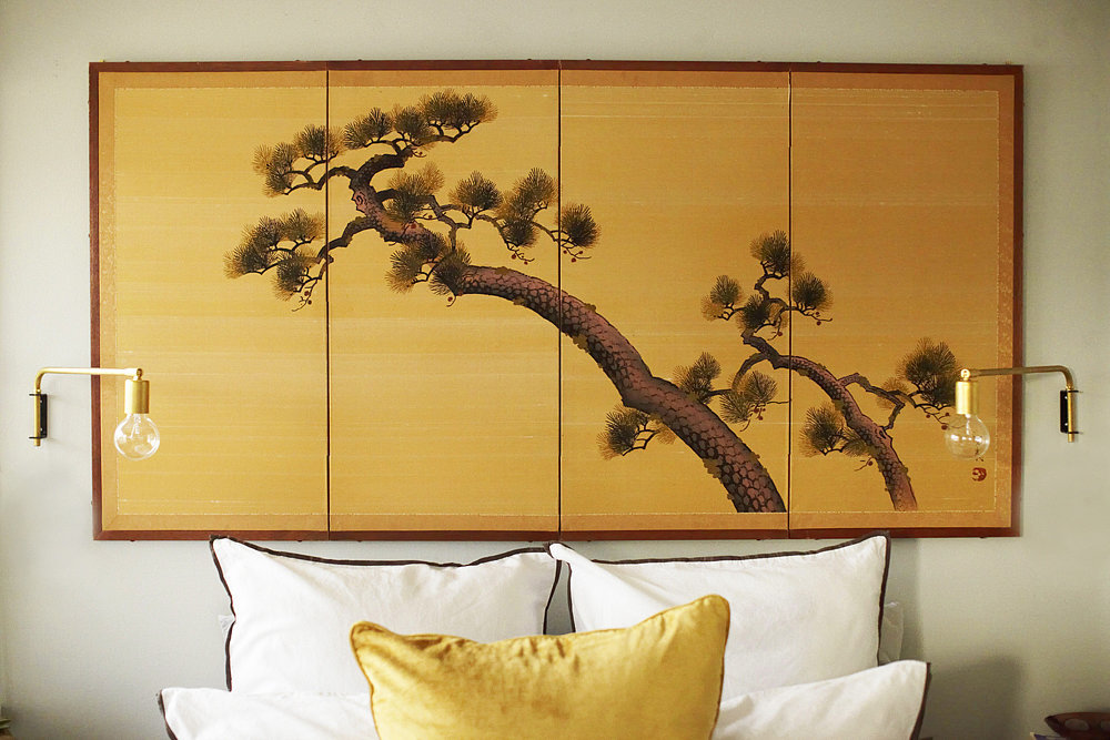 Nothing makes a bedroom like a unique headboard. This Japanese headboard doubles as art and is an alternative way to decorate over the bed.  Photo by Zeke Ruelas via Homepolish