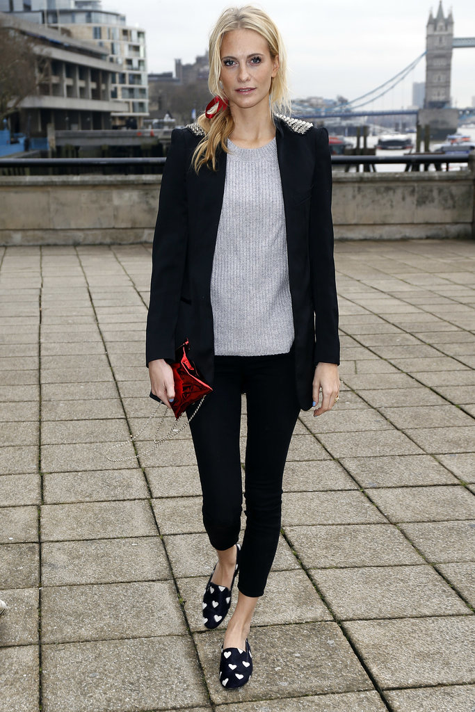 Don't you love it when a model exhibits and outfit that's super-easy to recreate? Poppy Delevingne did just that in London with a grey jumper and skinny-cut trousers. Follow her cues and finish with a blazer and add printed smoking slippers.