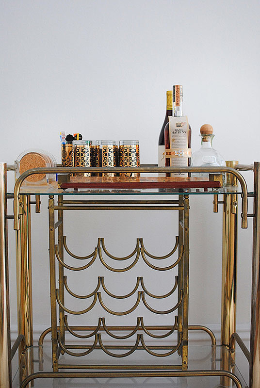 Casey had a blast accessorizing this gorgeous bar with vintage finds — from the glasses down to the swizzle sticks.  Source: Homepolish