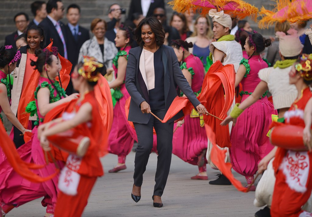 First Lady Michelle Obama joined performers waving flags in Xi'an.