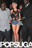 Miley Cyrus put her legs on display after a concert in Miami on Saturday.
