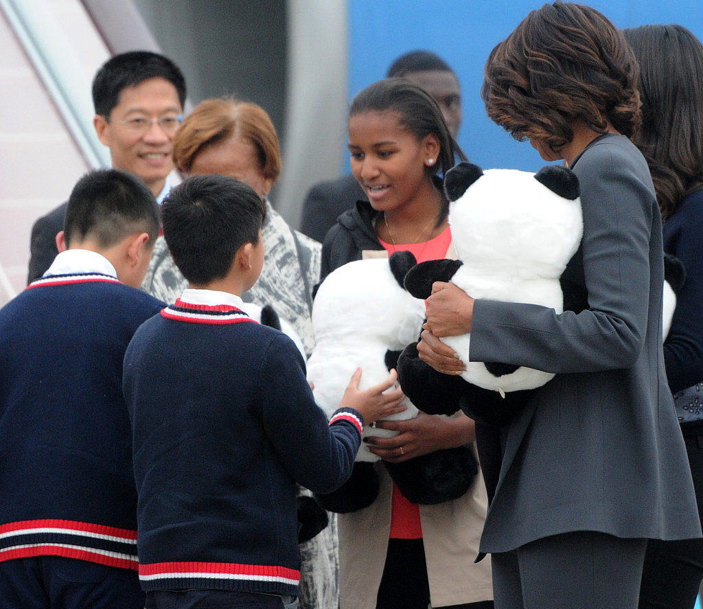 When the group touched down in Chengdu, children gave them panda stuffed animals.