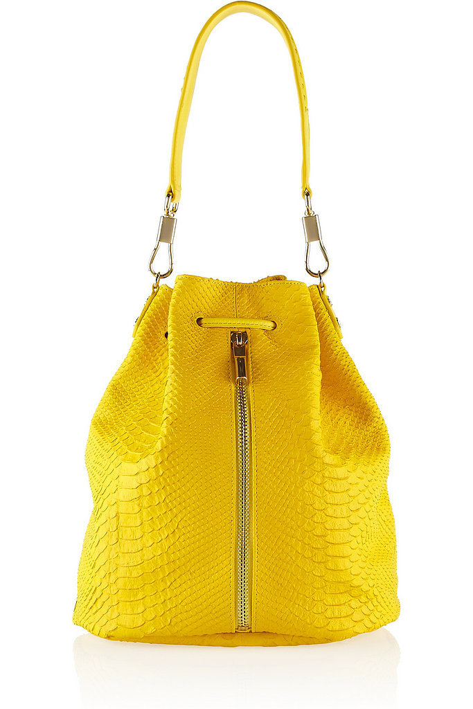Elizabeth and James bright yellow, snake-effect Sling backpack ($645)