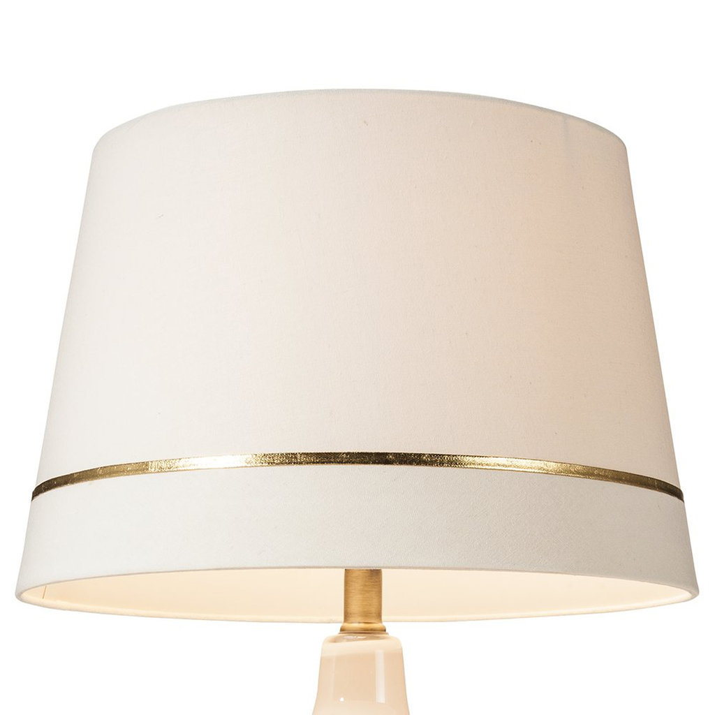 This gold-striped lampshade ($17, originally $25) is ideal for adding a pop of metallic to a room.