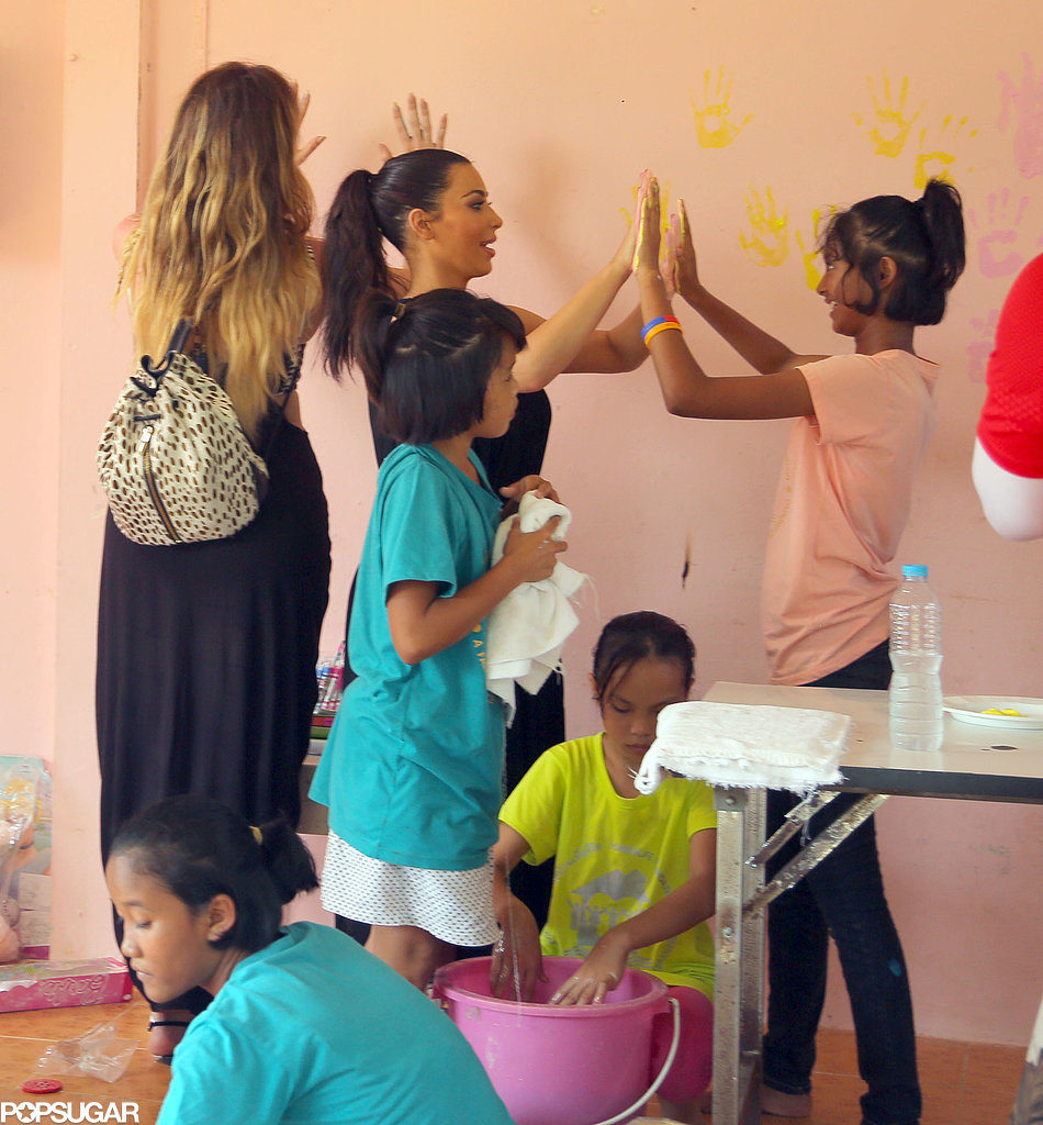 Kim and Khloé played with kids at an orphanage.