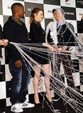Emma laughed as Andrew was covered in Spider-Man's webs at a Tokyo press conference in March 2014.