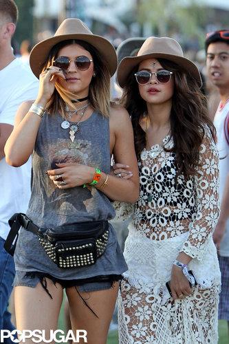 Selena Gomez held Kylie Jenner's arm.