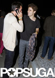 Paul Wesley laughed with a friend.