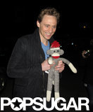 On Thursday, Tom Hiddleston posed with a sock monkey gift he was given by a fan in Toronto.