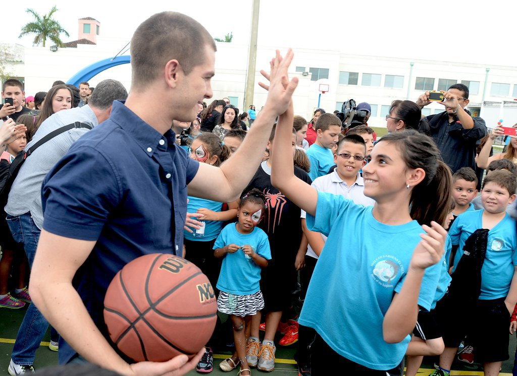 At an event in Miami in April 2014, Andrew played basketball with elementary school students.