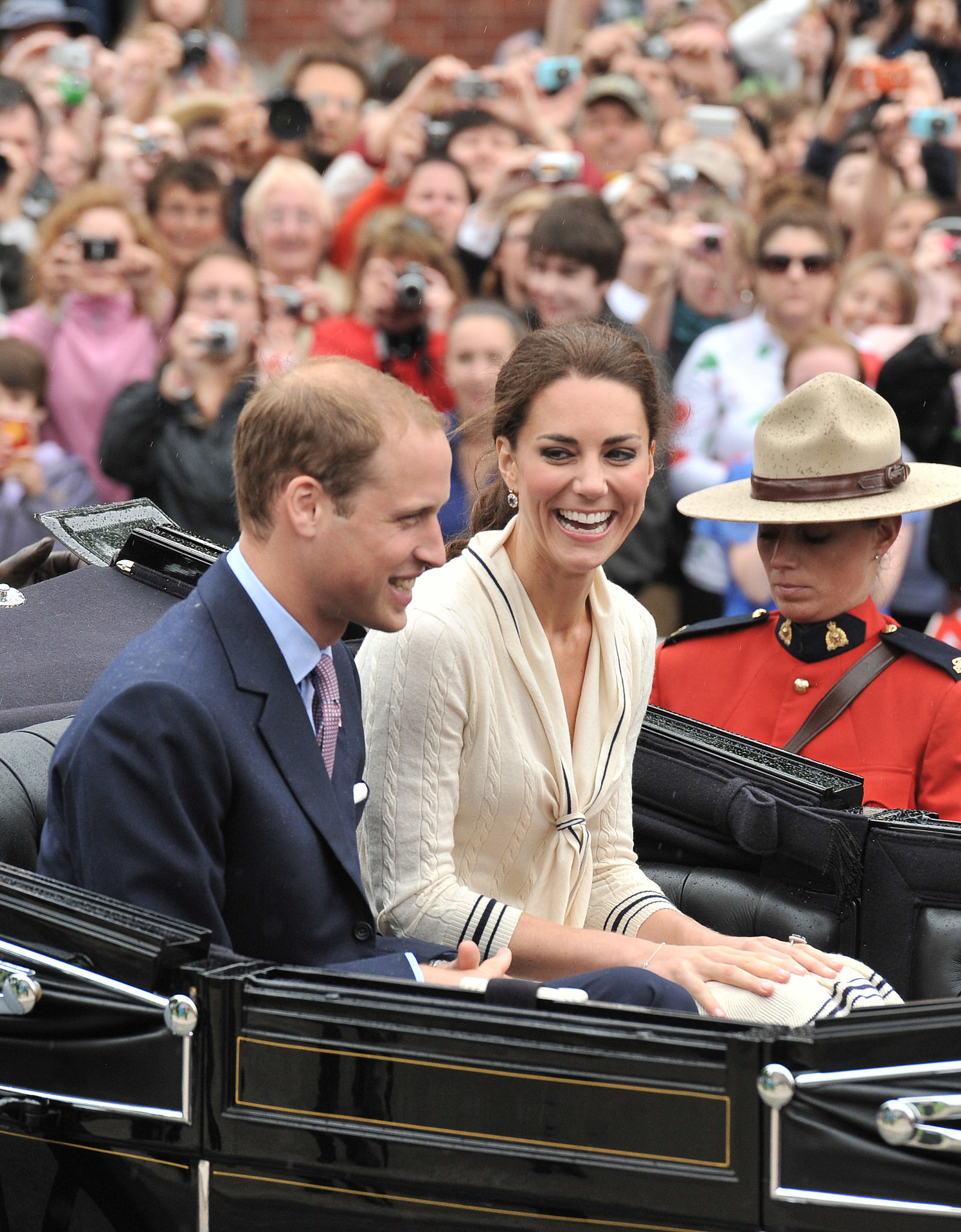 Kate and Prince William shared a laugh on Prince Edward Island in July 2011.