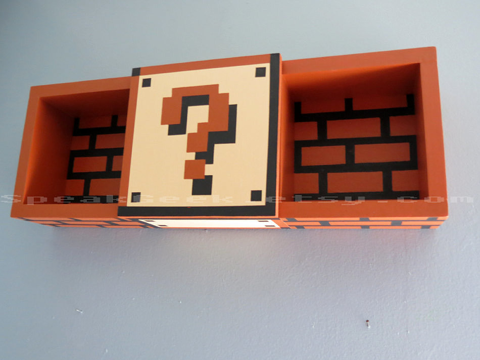 Super Mario Bros. shadow box shelf ($69)? We'll take five, thank you.