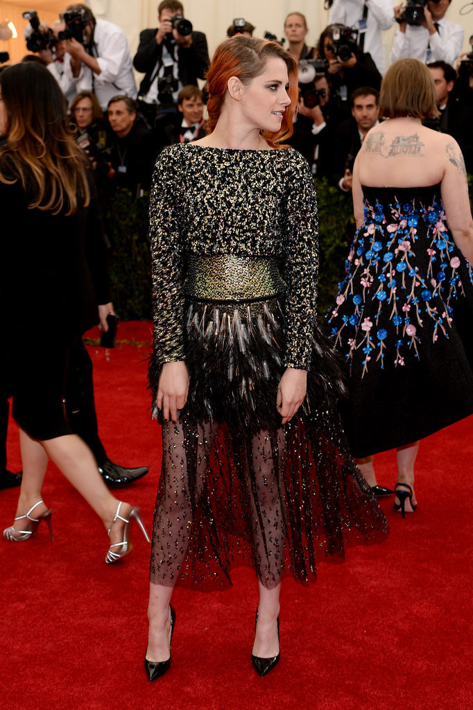 Lena Dunham's back tattoo takes up a good chunk of pixels in Kristen Stewart's side profile pic.