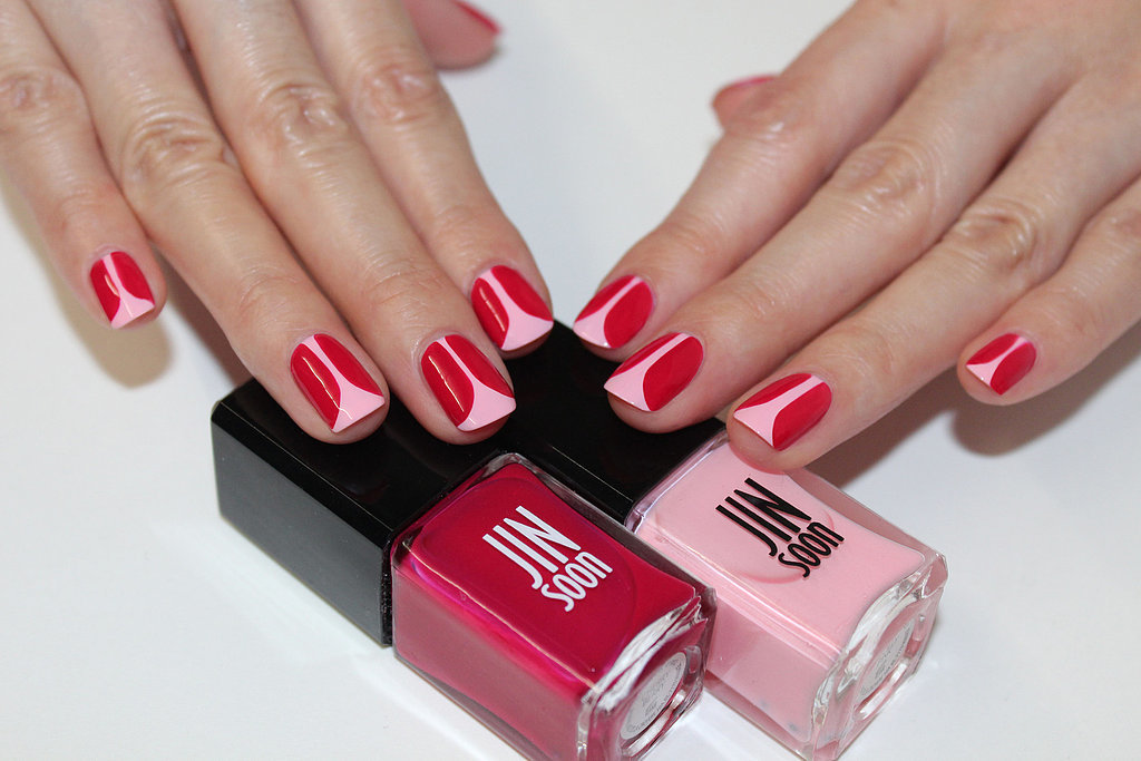 File and shape your nails to a natural square shape. Apply a base coat like Jin Soon Power Coat ($18). Apply Jin Soon Dolly Pink ($18) on the entire nail bed. With a thin brush, create the tulip petals with Jin Soon Cherry Berry ($18).  Starting at the cuticle area, draw a straight line down toward the tip of