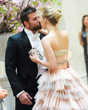 Bradley Cooper and Suki Waterhouse stopped for a kiss on their way into the party.