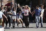Kurt, Mercedes, Rachel, Mike, Brittany, Blaine, and Sam dance in the street.