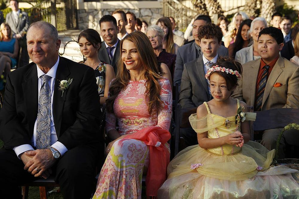 Jay (Ed O'Neill), Gloria (Sofia Vergara), and Lily (Aubrey Anderson-Emmons) on Modern Family.