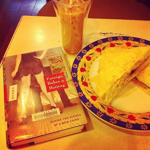 "Whatamireadingtoday captioned this, ""Reading this fascinating book over afternoon tea before getting back to work."""