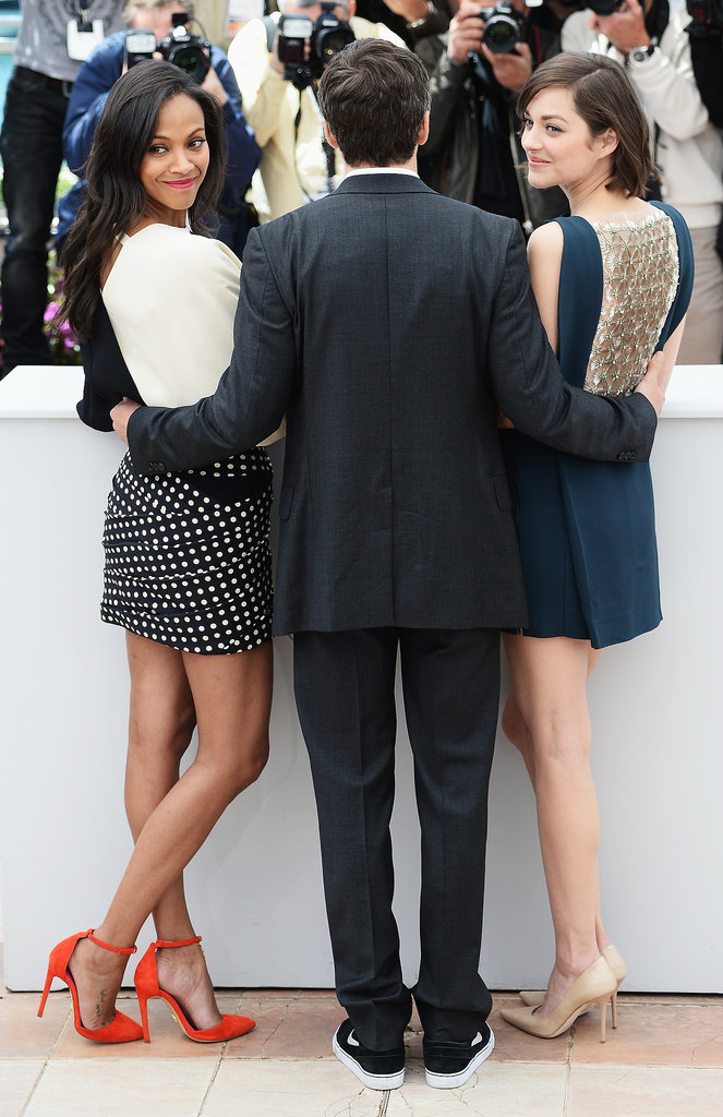 Zoe Saldana and Marion Cotillard posed with Guillame Canet at a photocall for Blood Ties in 2013.
