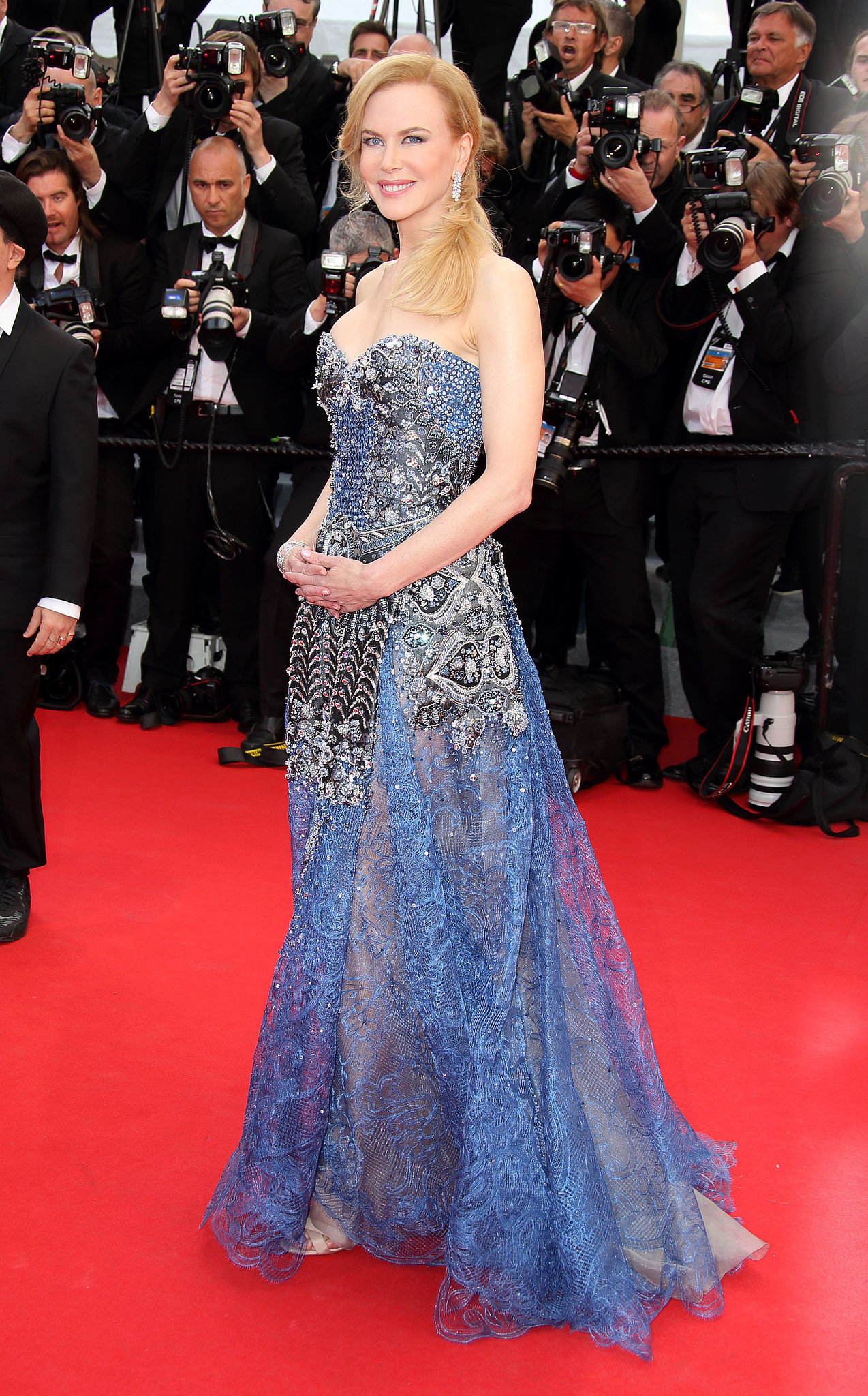 Nicole Kidman kicked off the festivities in a blue and metallic Armani Privé gown at the star