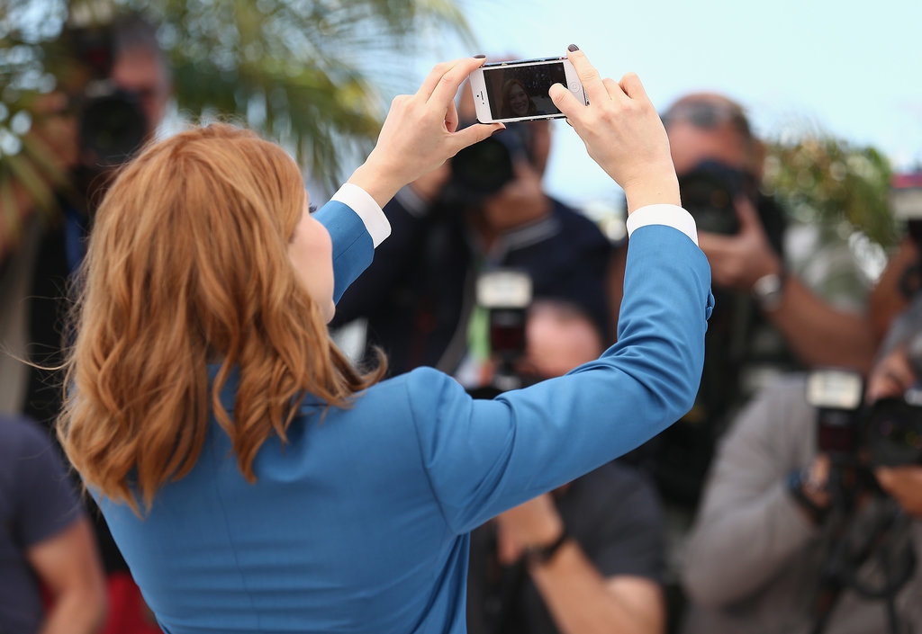 Léa Seydoux snapped an adorable selfie at the Saint Laurent photocall.