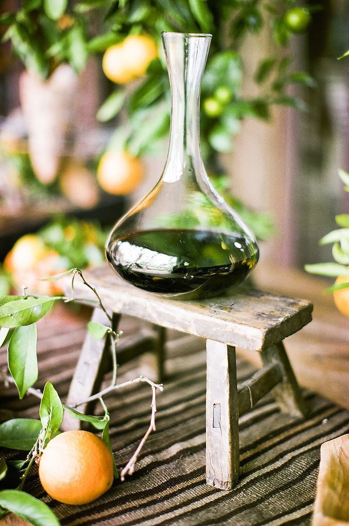 While a bowl of lemons can add a bright pop to the table, why not go the unexpected route and litter the table with single lemons still on the branches. The leaves offer a light citrus scent and add depth and texture.  Photo by Style Me Pretty