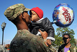 Specialist Marqes Turpin of the 273rd Military Police Company of DC Army National Guard kissed his 2-year-old son Josiah Turpin during a homecoming ceremony on Oct. 16, 2012, in Washington DC after a 10-month deployment to Afghanistan.
