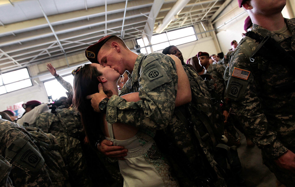 Sgt. Patrick Hopkins embraced his fianceé, Cara Benz, when he returned from a yearlong tour in Iraq with the US Army's 82nd Airborne Division on July 30, 2010, in Fort Bragg, NC.