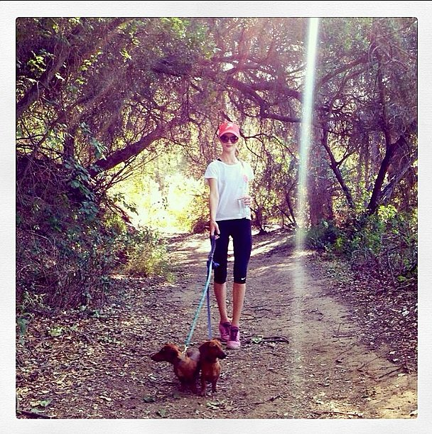 Rosie Huntington-Whiteley knows the best way to sneak in extra calorie burn — a leisurely hike with the dogs! Source: Instagram user rosiehw