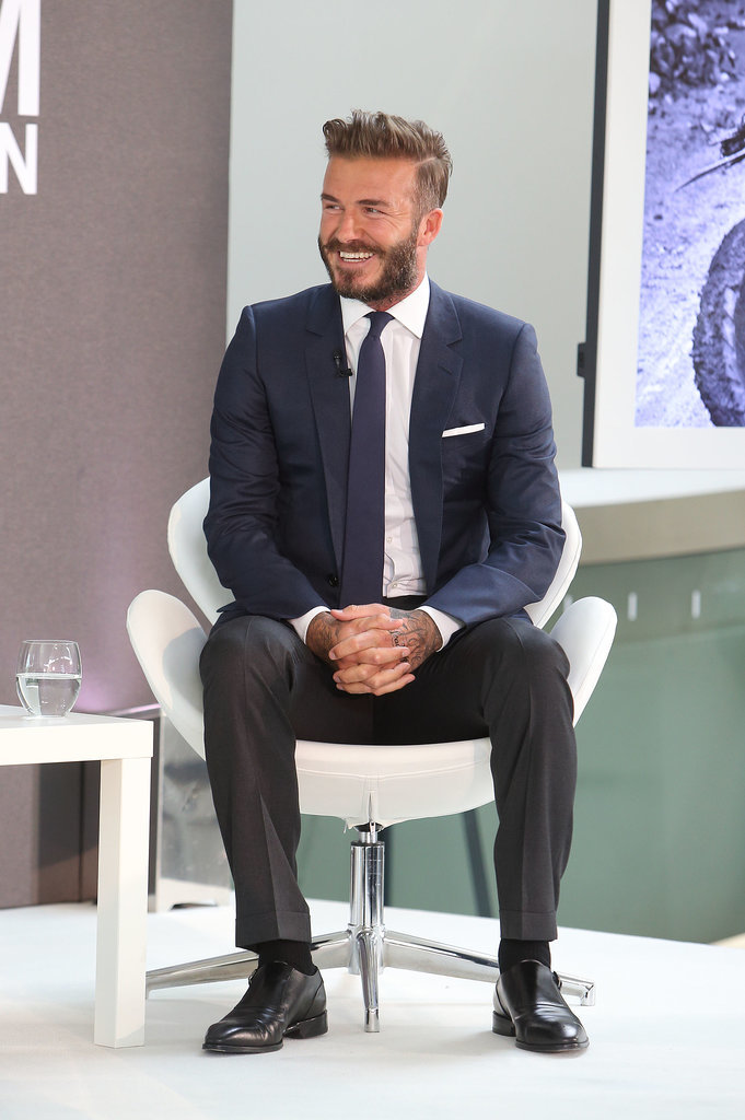 David Beckham laughed at a photocall for Into the Unknown in London on Monday.