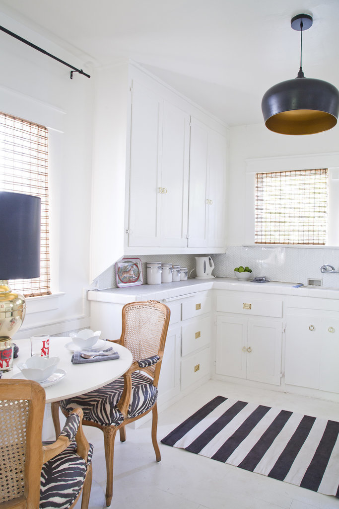 Gold in a kitchen? Yes. Why? Because it adds a glamorous touch, especially against white cabinets. To get the look on a budget, try this gold hardware DIY; it's a great way to personalize a rental kitchen.  Source:  Bethany Nauert via Homepolish