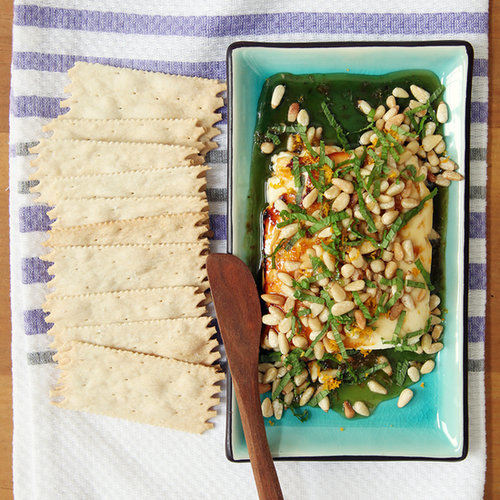 Warm Honey-Drizzled Feta With Pine Nuts, Orange Zest, and Mint
