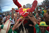 A Mexico fan crowd-surfed on Copacabana Beach in Brazil.