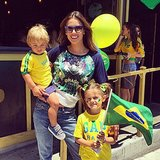 Alessandra Ambrosio showed off her pride for Team Brazil at the World Cup with her daughter, Anja, and her son, Noah. Source: Instagram user alessandraambrosio