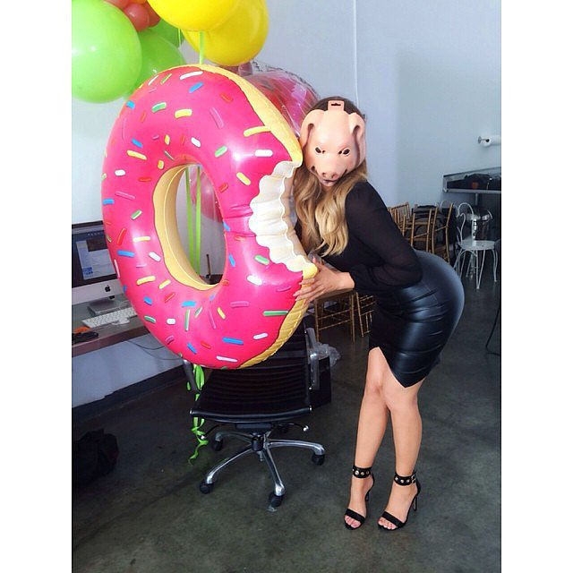 Khloé Kardashian wore a pig mask and posed with a giant inflatable doughnut. Source: Instagram user khloekardashian