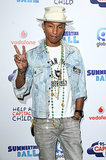 Pharrell Williams was all about denim and peace at the Capital FM Summertime Ball at Wembley Stadium in London on Saturday.