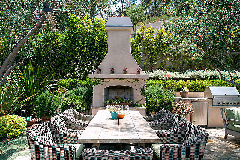 The custom fireplace and grill are perfect for outdoor entertaining.  Source: David Offer