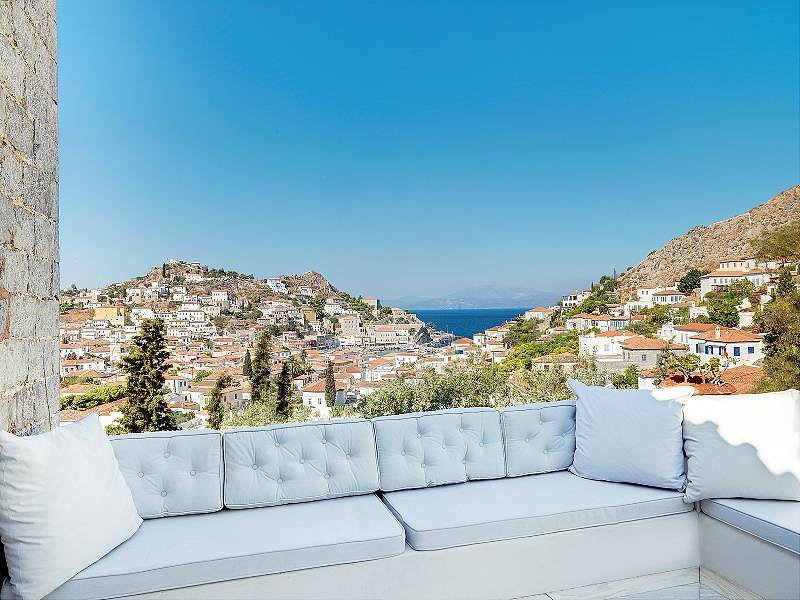 Tucked away in the hills of Greece, this charming stone house includes a picturesque view of the hillside and ocean. Source: Christie's International Real Estate